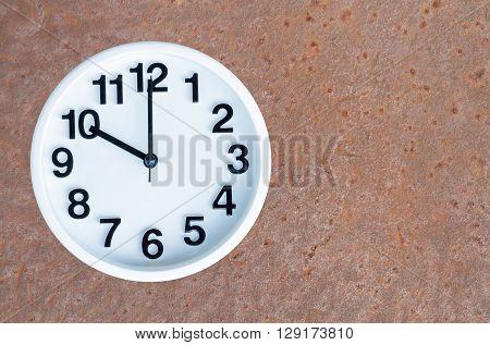 Clock On Steel Rusty Background