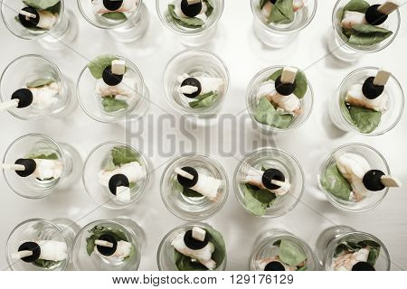 Catering buffet table with a delicious food on white background