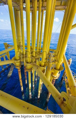 Well casing and well slot at drain deck of oil and gas remote platform.