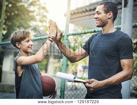 Trainer High-Five Teamwork Ability Concept