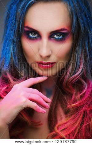 Portrait Of Beautiful Girl With Blue And Red Hair In The Studio