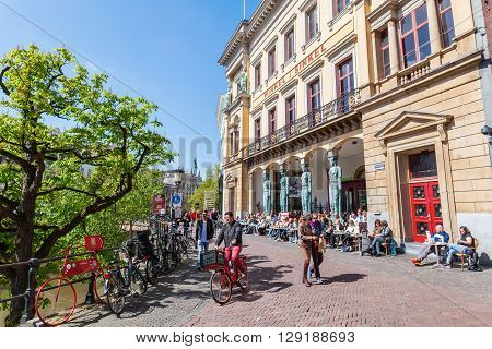 Utrecht Netherlands - April 20 2016: Winkel van Sinkel building with unidentified people. Originally it was a store opened 1839. Today it is by day a cafe and at night a club
