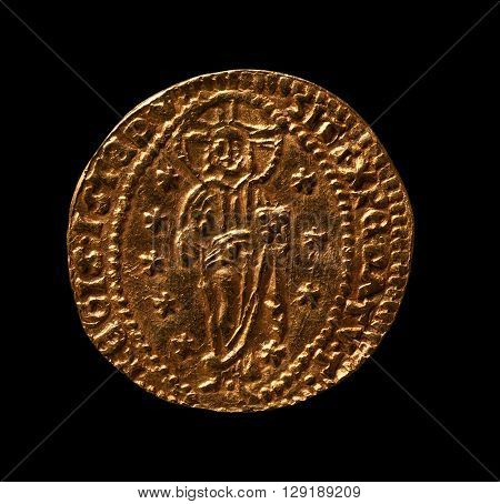 Gold coin of medieval Venice ducat macro shot