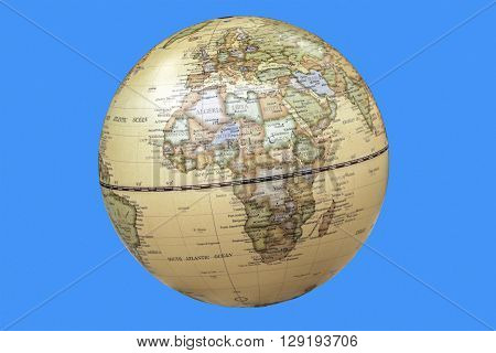 Continent of africa depicted on world globe isolated on blue background