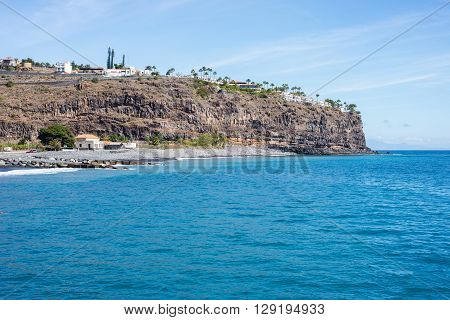 Steep coast at the tourist destination Playa de Santiago on the canary island La Gomera. The village is situated in the south of the island, where it is dry. The sun shines every day