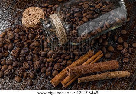 Coffee jar, cinnamon on wooden backgrounnd, closeup