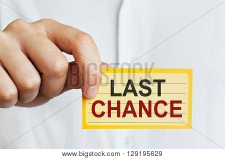 Last Chance Concept. Card in male hand