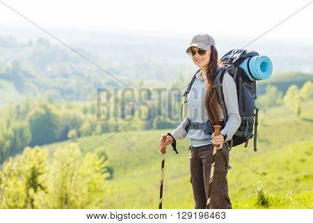 Hiker Backpacker Girl Enjoing Journey In Mountains