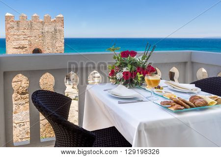 Breakfast on terrace with view on sea