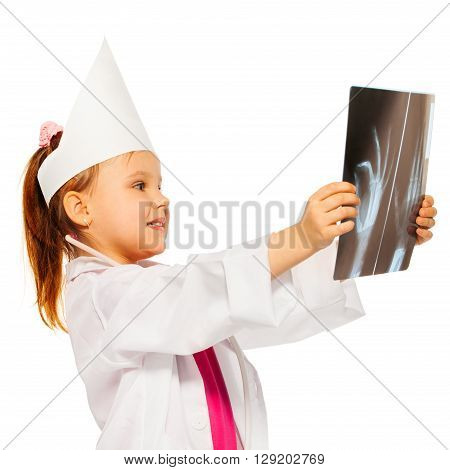 Young girl dressed like a doctor radiologist studying an x-ray of the wrist, isolated on white