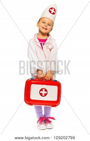 Cute little girl dressed like a doctor holding toy first-aid kit, isolated on white