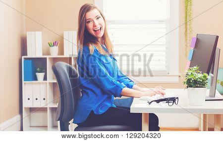 Happy Young Woman Using A Her Computer