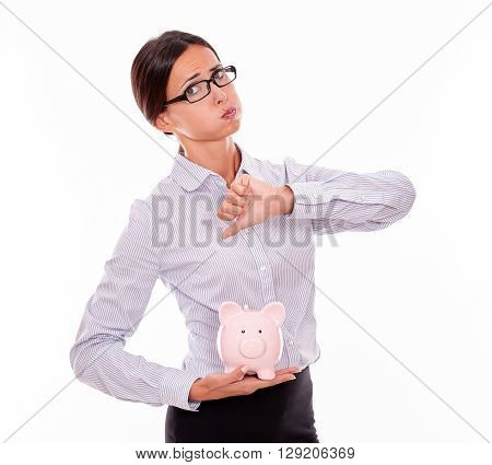 Businesswoman Holding Piggy Bank With Disapproval