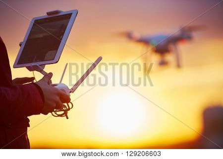 drone quadcopter flying at sunset poster