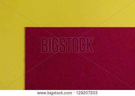 Eva foam ethylene vinyl acetate sponge plush red surface on lemon yellow smooth background
