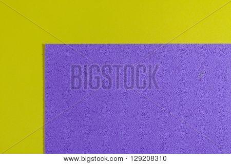 Eva foam ethylene vinyl acetate sponge plush light purple surface on lemon yellow smooth background