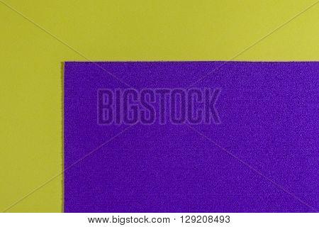 Eva foam ethylene vinyl acetate sponge plush purple surface on lemon yellow smooth background