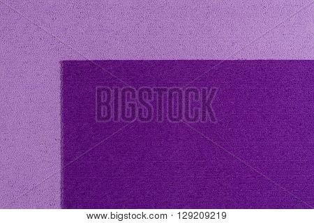 Eva foam ethylene vinyl acetate purple surface on light purple sponge plush background
