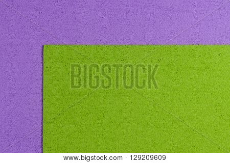 Eva foam ethylene vinyl acetate apple green surface on light purple sponge plush background
