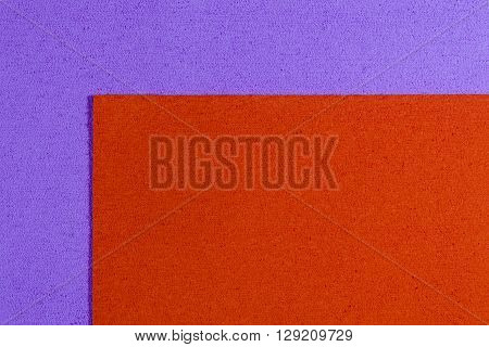 Eva foam ethylene vinyl acetate orange surface on light purple sponge plush background