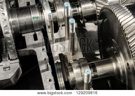 A part of a small steam turbine. Metal gears. Gear wheels of the engine.