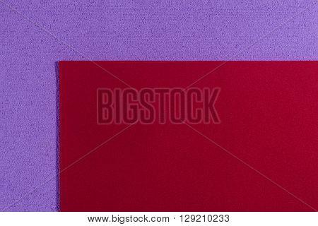 Eva foam ethylene vinyl acetate smooth red surface on light purple sponge plush background