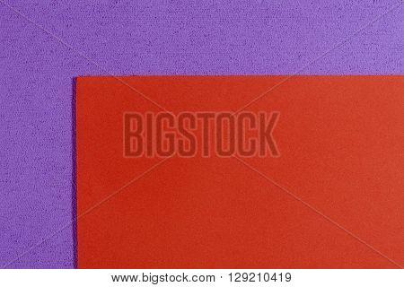 Eva foam ethylene vinyl acetate smooth orange surface on light purple sponge plush background
