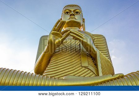 Sri Lanka Danbulla detail of the large Buddah statue at the entrance of the Golden Temple