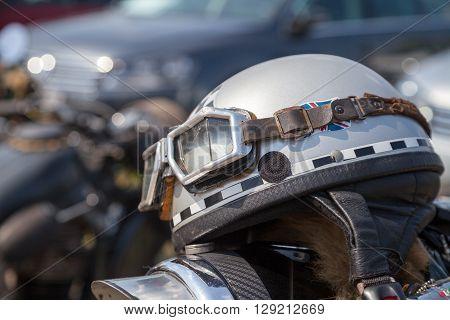 an oldtimer motorcycle helmet lies on motorcycle