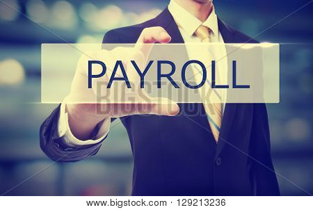 Business Man Holding Payroll