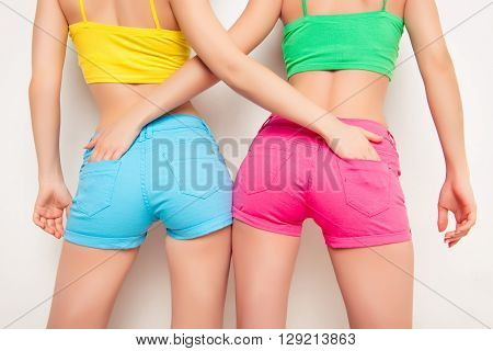 Close Up Photo Of Shapely Woman's Buttocks In Color Shorts
