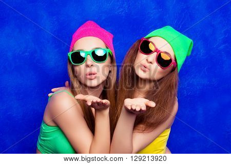 Two Hipster Young Woman In Glasses Sending Air Kiss