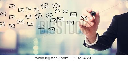 Businessman Drawing E-mails Concept