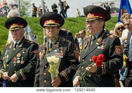 Kyiv, Ukraine - May 8, 2009: Three senior army officers in full dress uniform hold bouqets at Victory Day celebration at the Museum of The History of Ukraine in World War II in Kyiv