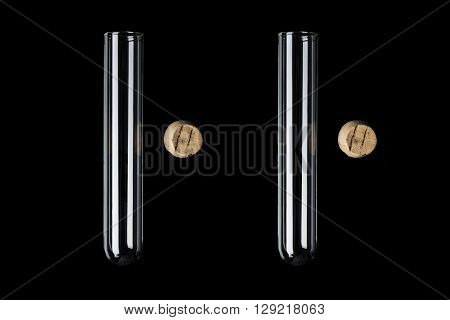Two glass transparent test tubes with cork on side on black background