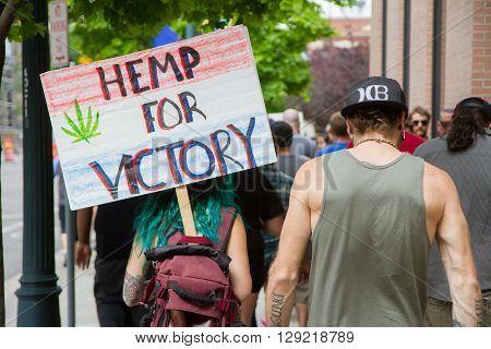 BOISE IDAHO/USA - MAY 7 2016: Woman walking to the Boise Capital during the Global Marijuana March in Boise