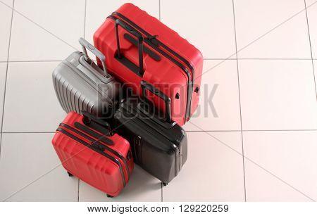 Suitcases on tile background