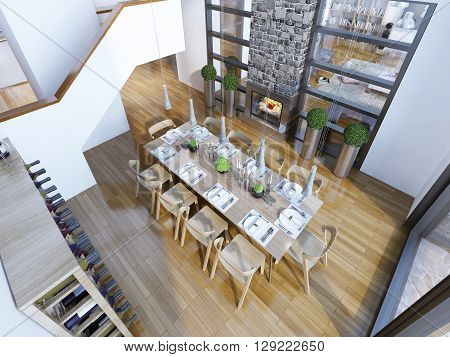 Idea of loft style dining room. Top view of the high ceiling dining room with served table for ten persons. The white walls and brown furniture with parquet floors. Gray hanging lamps fireplace and a wine rack. 3D render