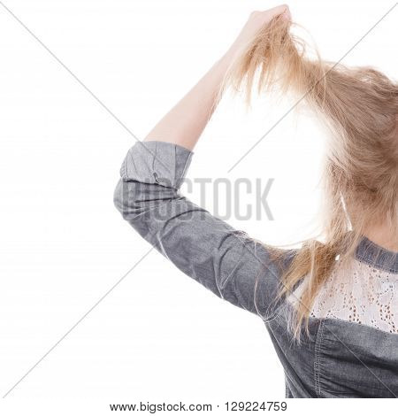 Fury and big anger inside of people. Blonde furious woman pulling blonde hair out of head. Emotional young girl showing her bad expression.