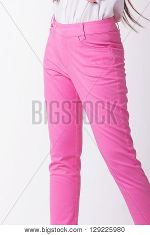 Close up pink women trousers in white background.