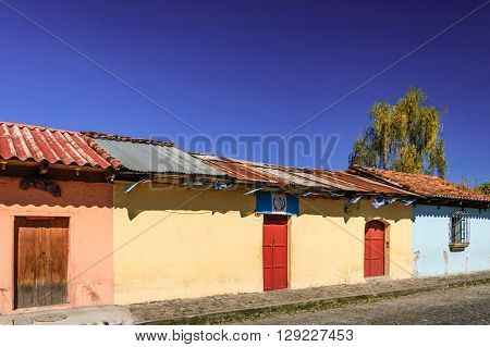 Antigua Guatemala - October 5 2014: Old colorful painted houses adorned with Guatemalan flags in colonial city & UNESCO World Heritage Site of Antigua.