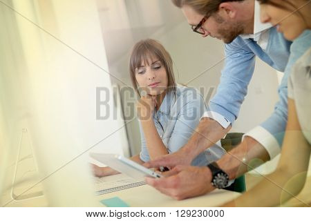 Business people working in office, meeting with tablet