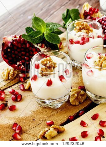 Yogurt Dessert With Walnuts And Pomegranate Selective Focus