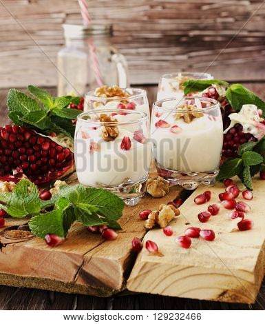 Yogurt Dessert With Walnuts And Pomegranate Selective Focus
