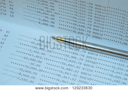 bank statements with pen , business concept