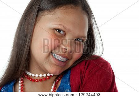 A teenage girl is happy to show her braces.