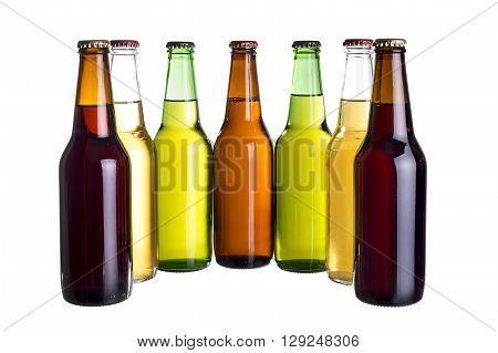 Group of unlabeled variety of beer bottles isolated on a white background