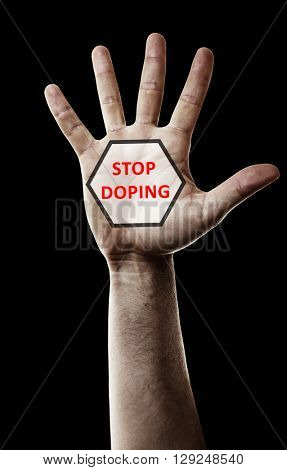 Stop doping concept. Male hand with sign isolated on black