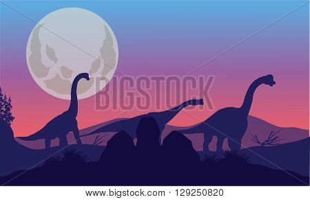 Brachiosaurus of silhouette with moon at the night