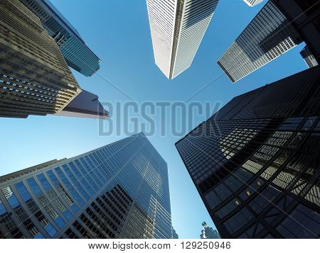 TORONTO CANADA - 4TH JUNE 2015: A low angle view of buildings in downtown Toronto during the day.